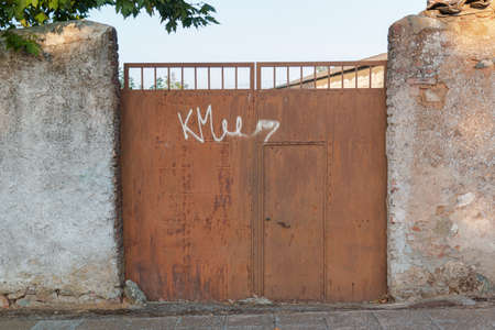 Beautiful couples, fields and landscapes of the Cordoba mountains in Spain. Photograph taken in the month of July. Rusty door with gratitti