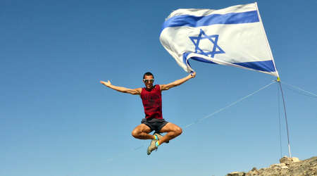 mountin: The man jumped. Mountin view. Eilat. Israel Flag