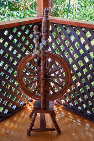 Old traditional wooden spinning yarn wheel. Sochi, Russia Stock Photo