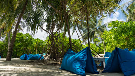 Nice place for relaxing on the island with poufs under palm trees, Maldives Stock fotó