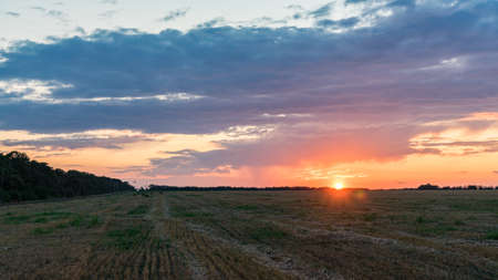 Beautiful Sunrise over the field.Summer evening in Blagoveshenskaya. Anapa