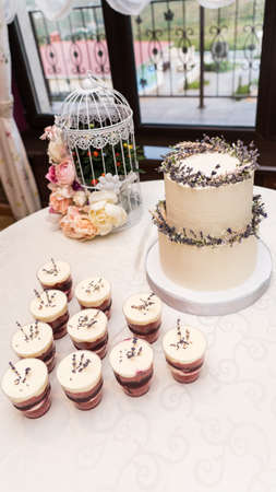 Elegant wedding cake decorated with flowers and succulents