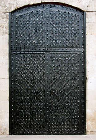 Old black iron door Фото со стока