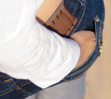 Standing backwards woman with hand in pocket Stock Photo - 11854624