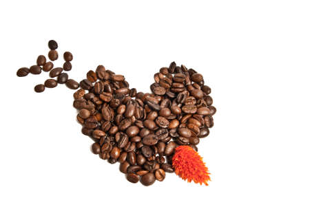 Heart from coffee beans and arrow Stock Photo - 11989473