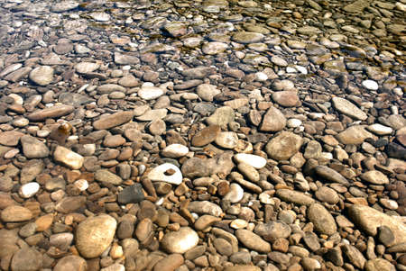 Rocks in a shallow pond Stock Photo - 12314176