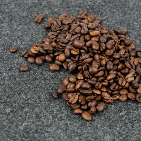 Coffee beans  on a grey background photo
