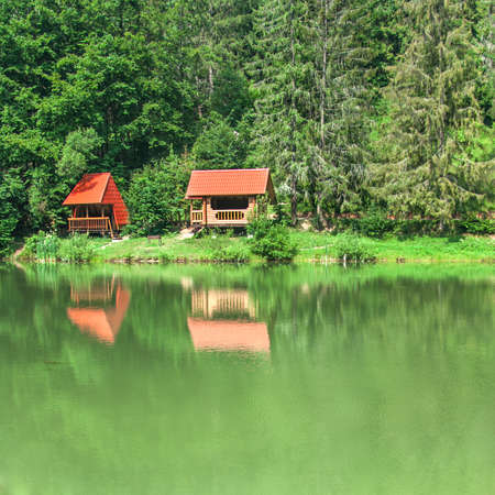 Beautiful wooden house near the river in wood photo