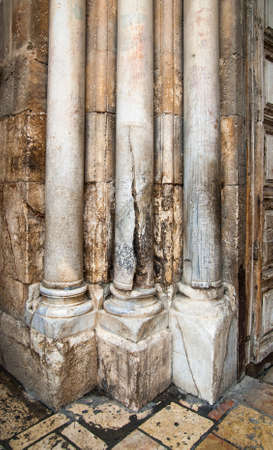 Columns at an input in Church of the Resurrection in Jerusalem, Israel photo