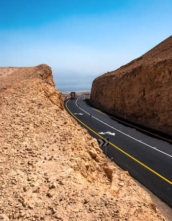 Asphalt Road in the Desert of Israel on the way to Dead Sea Stock Photo