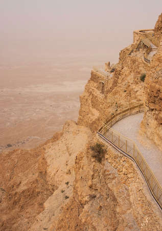 Masada mountain in the haze, israel photo