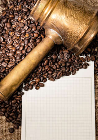 Blank notebook with arabic copper turks and coffe grains Stock Photo - 13693259