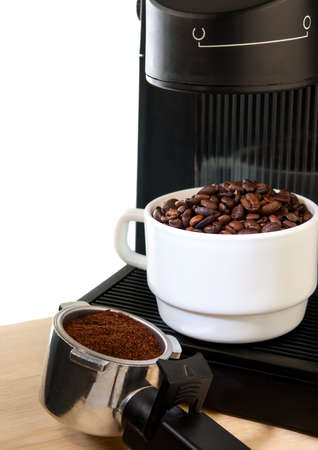 Close up coffee maker machine with white coffee cup and coffe bean photo