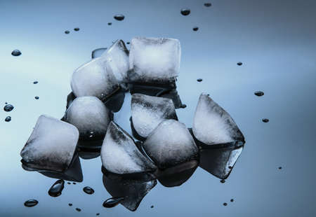 wet ice cubes on black glossy mirror background Stock Photo - 14123090