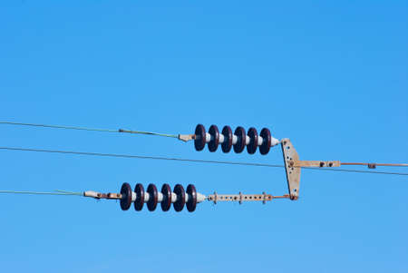 Railroad wire pole against clear blue sky photo