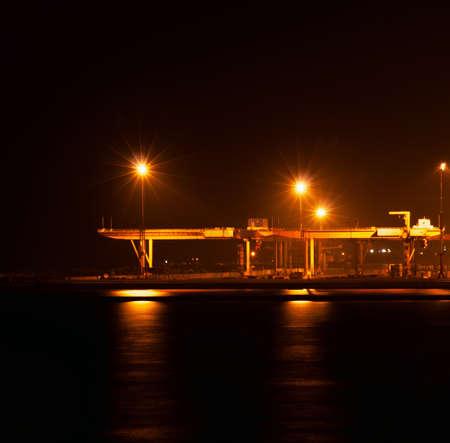 floodlights: the industrial port at night under floodlights