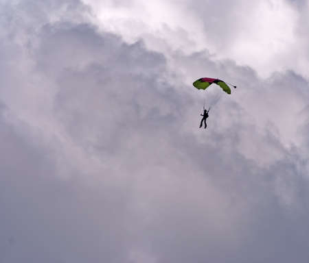 paraglide: Paraglider - Feeling free on the grey sky