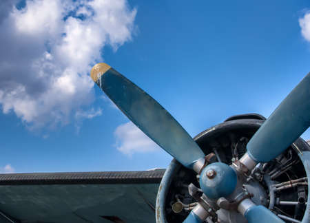 Propeller and engine of vintage airplane photo