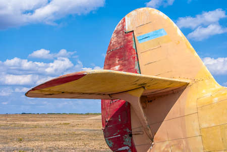 the tail part of the old plane the blue sky background Stock Photo