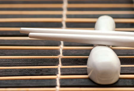 hashi: Japanese white sticks hashi on dark mat