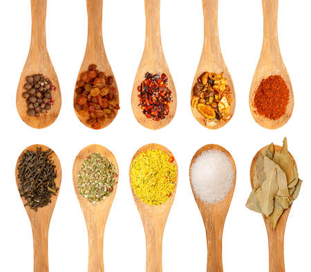 wooden spoons with seasonings on a white background, each one is shot separately Stockfoto