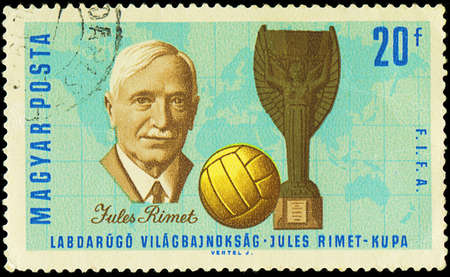 HUNGARY - CIRCA 1966  A stamp printed in Hungary shows Jules Rimet  1873-1956  who was the 3rd President of FIFA, Cup and Soccer Ball, circa 1966 Redactioneel
