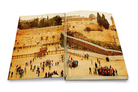 An opened old book with a picture Western Wall,Temple Mount, Jerusalem, Israel  Photo in old color image style on white background