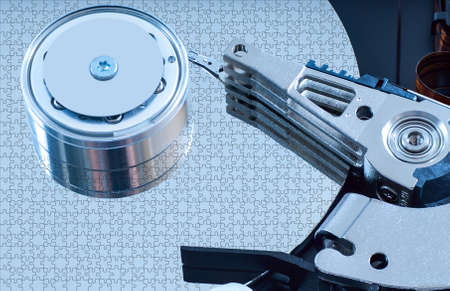 harddisk: Hard disk detail with a blue hue to accentuate the coldness of technology Stock Photo