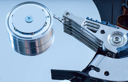 Hard disk detail with a blue hue to accentuate the coldness of technology photo