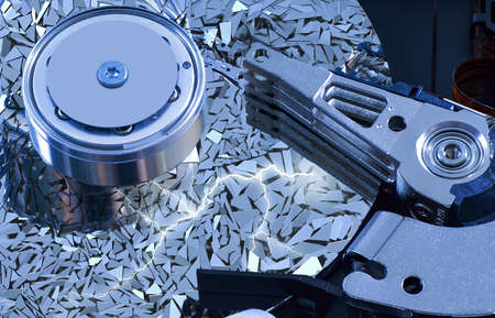 harddisk: Hard disk detail with a blue hue with surface splinters Stock Photo