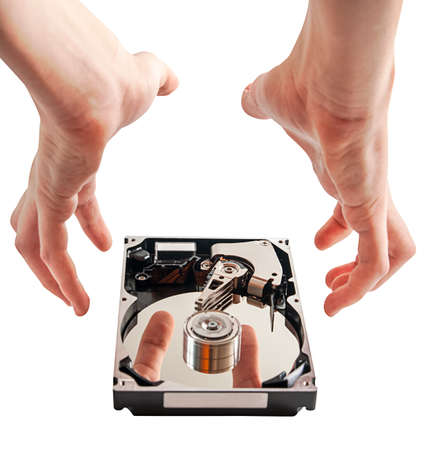 Hard drive details and hands, concept of data security, on a white background photo