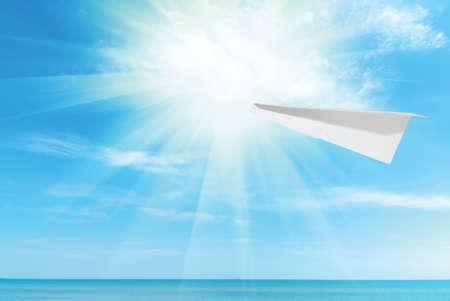 paper plane against beautiful blue Caribbean sky, sea and sun photo
