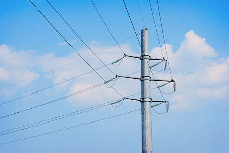 isolator insulator: electric wires pole on a background of blue sky