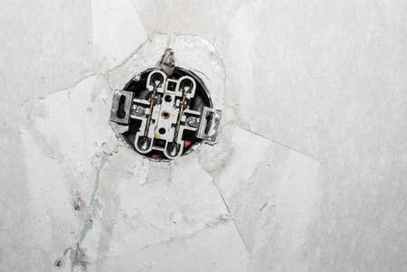 grungy white background of natural cement with open electric socket