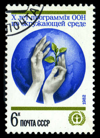 un used: USSR - CIRCA 1982: a stamp printed by USSR shows feminine hands and Globe - symbol of UN, Human Environment, circa 1982 Editorial