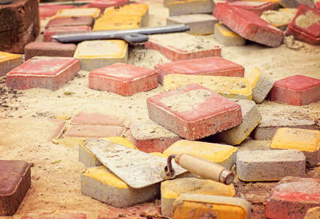 Stone blocks laying down on sand photo