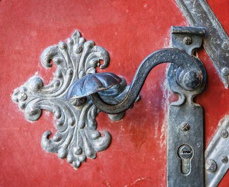 doorhandle: Door-handle decoration detail of old metal iron entrance door in Prague Stock Photo