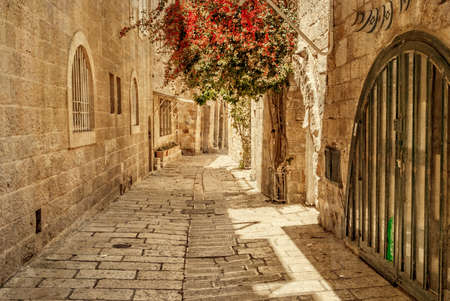 jewish houses: Ancient Alley in Jewish Quarter, Jerusalem. Israel. Photo in old color image style. Stock Photo