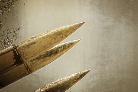 artillery shell: Grunge Army Missile.  Photo textured in old color image style.