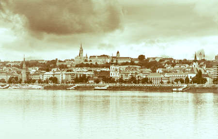 buda: View of Buda side of Budapest with the Buda Castle, St. Matthias and Fishermens Bastion. Vintage style