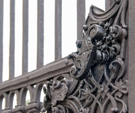 steel texture: Vintage forged decorative element on metal gate in old part of Vienna, Austria Stock Photo