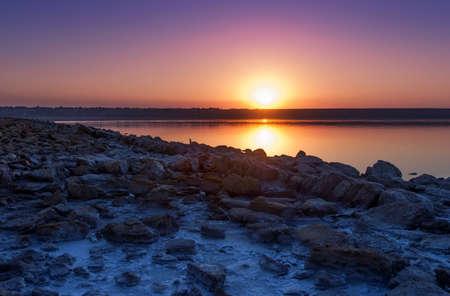 Colorful bright orange blue summer sunset over lake Stock Photo