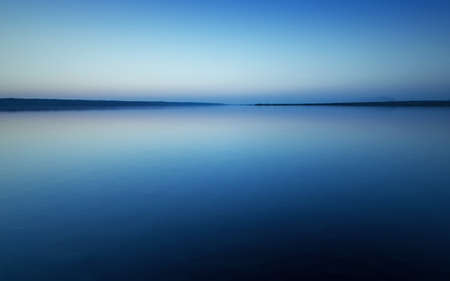 Colorful bright blue summer sunset over lake Stock Photo