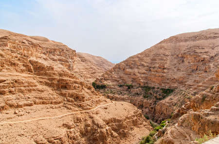 Wadi Qelt in Judean desert around St. George Orthodox Monastery, or Monastery of St. George of Choziba, Israel