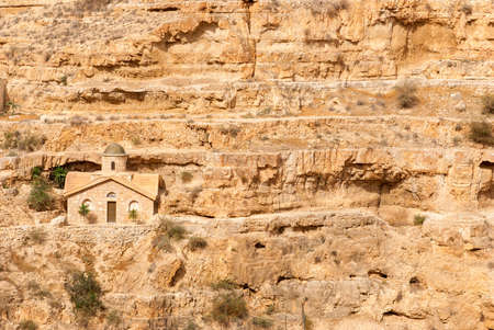 inhabited: St. George Orthodox Monastery is located in Wadi Qelt. The sixth-century cliff-hanging complex, with its ancient chapel and gardens, is still inhabited. Stock Photo