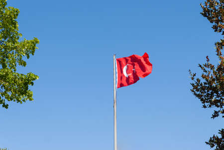 Turkish flag waving in blue sky, Istanbul