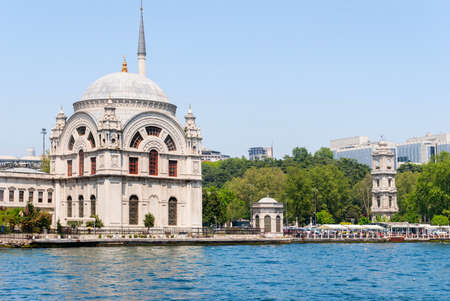 Dolmabahce Mosque. Famous historical structure of Istanbul and a view from the sea.