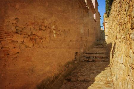 Spain, Tossa de Mar, cobbled street in medieval Old Town - Vila Vella