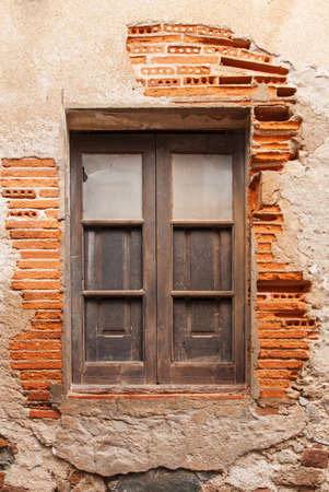 Wooden window in the wall of the ancient building in medieval Old Town - Vila Vella Spain, Tossa de Mar. Stockfoto