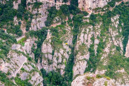 Yellow cable car in the Aeri de Montserrat rise to de Montserrat Abbey near Barcelona, Spain, Catalonia Stockfoto - 121868560